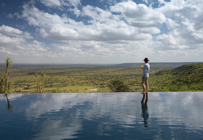 Loisaba-Tented-Camp-infinity-pool-with-lady-and-view